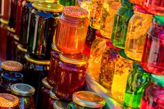 Pots with different sorts of honey. Glass jars with different sorts of honey in Russian marketplace Royalty Free Stock Photos