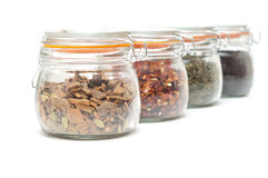 Glass jars with different types of tea Royalty Free Stock Images