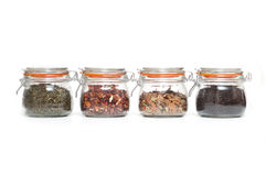 Glass jars with different types of tea Stock Images