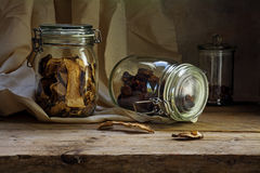 Glass jars with dried food on an rustic wooden shelf, countrysid Stock Image