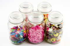 Glass jars filled with candy Royalty Free Stock Photo