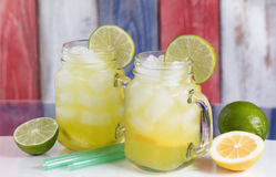 Glass jars filled with cold lemonade on USA national colors for Stock Photo