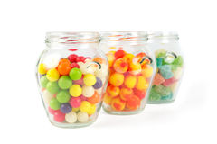 Glass jars filled with different colorful candies Stock Image