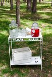 Glass jars of fresh lemonade on wedding candy bar. Summer party. And reception in forest Stock Images