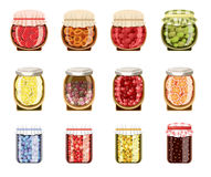 Glass jars with fruit and berry jam Royalty Free Stock Photos