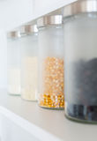 Glass jars with grain Royalty Free Stock Photos