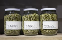 Glass jars with green mung beans munggo on dispaly in a store stock photo