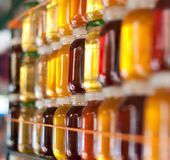Glass jars with honey Stock Images