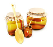 Glass jars of honey and wooden spoons. 3d. Stock Photo