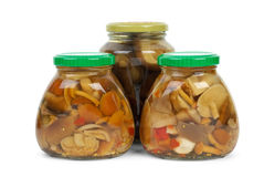 Glass jars with marinated mushrooms Stock Photo