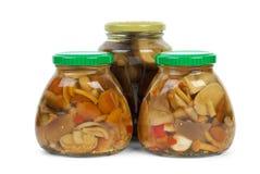 Glass jars with marinated mushrooms Stock Photo