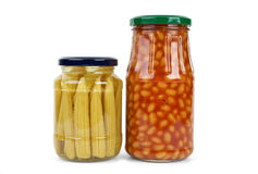 Glass jars with marinated vegetables Stock Images