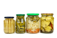 Glass jars with marinated vegetables Stock Image