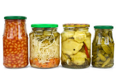 Glass jars with marinated vegetables Royalty Free Stock Images