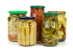 Glass jars with marinated vegetables Stock Photography