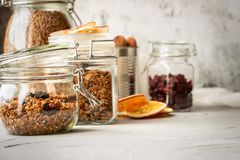 Glass jars with muesli in a on table stock image