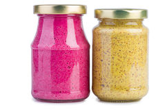 Glass jars with mustard horseradish sauce Stock Image