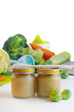 Glass jars with natural baby food on the table Royalty Free Stock Photography