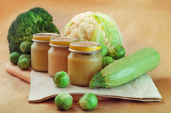 Glass jars with natural baby food Royalty Free Stock Images