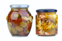Glass jars with olives and seafood Royalty Free Stock Images