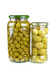Glass jars with pitted and giant green olives Royalty Free Stock Photography