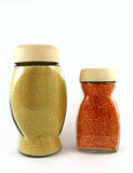 Glass jars of red lentils and breadcrumb Royalty Free Stock Photos