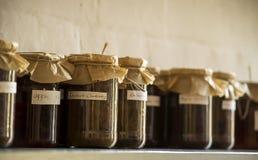 Glass jars on a shelf stock photo