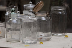 Glass  jars on a table in Park. Glass jars on a table in Park Stock Photography