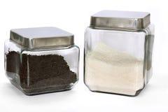 Glass jars with tea and sugar Stock Photos