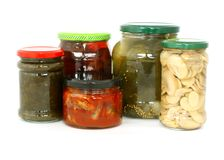 Glass jars with tinned products  on white Stock Photos