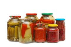 Glass jars with tinned vegetables Stock Images