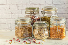 Glass jars with various legumes - beans, mung bean, peas and len stock photos
