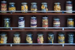 Glass jars with various varicoloured types of pasta Royalty Free Stock Image