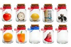 Glass jars on white Stock Photos
