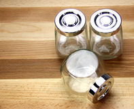 Glass Jars on a wooden background Stock Images