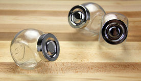 Glass Jars on a wooden background Royalty Free Stock Image