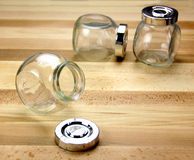 Glass Jars on a wooden background Royalty Free Stock Images