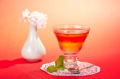 Glass with jelly, spearmint and a spoon Royalty Free Stock Image