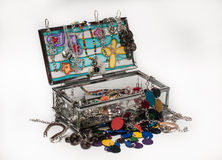 Glass jewelery box packed with accessories Royalty Free Stock Photos