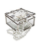 Glass jewelry box. With pearls necklace isolated on white background Royalty Free Stock Photo
