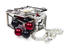 Glass jewelry box. Open glass jewelry box with colored beads  on white background Royalty Free Stock Photos