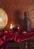 glass jordklottabell för antik konjak Arkivbilder