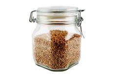 Glass jug with buckwheat Royalty Free Stock Photo