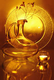 A glass jug, a candle and a plate Royalty Free Stock Photos