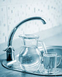 Glass jug and cup with water Royalty Free Stock Photos
