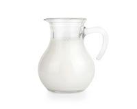 Glass jug of fresh milk Stock Photo