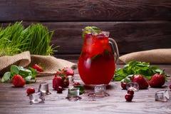 Glass jug of freshness lemonade. Royalty Free Stock Images