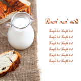 Glass jug with milk and bread. On a brown fabric on a white background Stock Photo