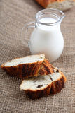 Glass jug with milk and bread Stock Image