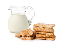 Glass jug with milk and cracker Royalty Free Stock Photo